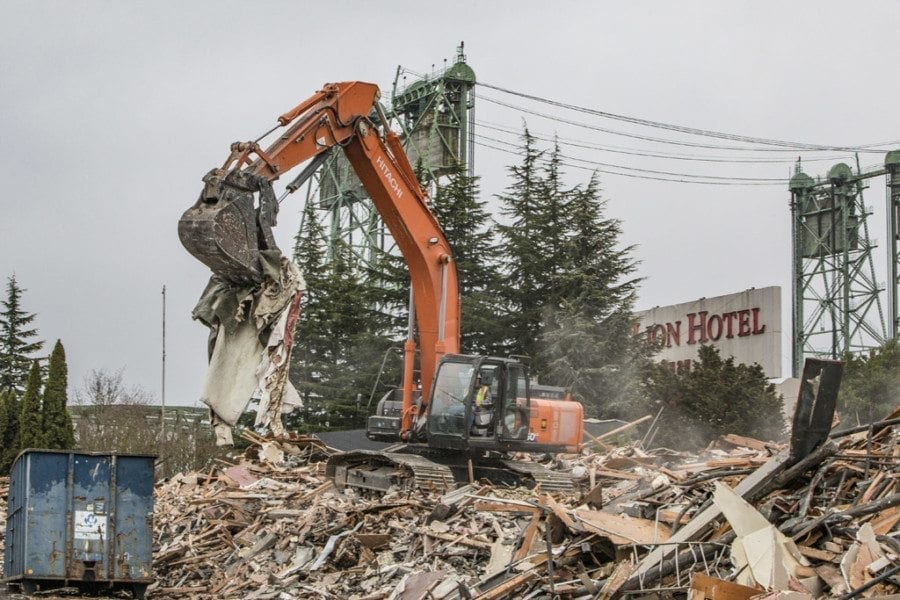 Demolition crews reduce much of the iconic Red Lion at the Quay hotel, which closed in 2015 after more than 50 years in business along Vancouver's Columbia River waterfront, to a pile of rubble on Fri., March 17. Photo by Mike Schultz