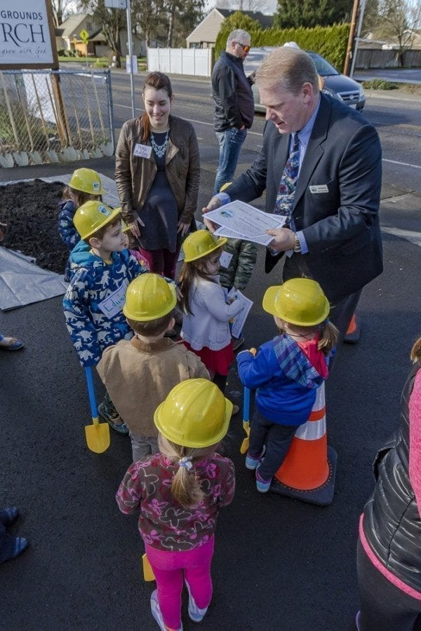 Battle Ground Public Works Director Scott Sawyer hands out certificates to each of the children from Battle Ground's Country Campus Learning Center who attended the South Parkway Improvement Project groundbreaking ceremony on Thursday morning. Photo by Mike Schultz