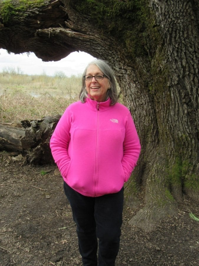Virginia Scott stands in front of the more-than-400-year-old Mother Tree in the Carty Unit of the Ridgefield National Wildlife Refuge. Photo by Carolyn Schultz-Rathbun