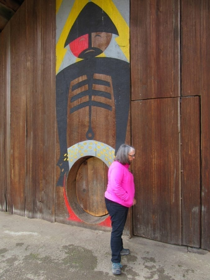 Virginia Scott is pictured here outside the main entrance of the Cathlapotle Plankhouse. Named for the ancient Chinookan village of Cathlapotle, the plankhouse was constructed based on information from the archaeological site of the village, which is within the Ridgefield National Wildlife Refuge. Photo by Carolyn Schultz-Rathbun