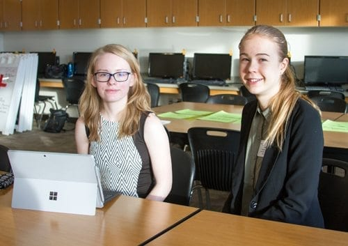 Bethany Humbyrd (left), a junior at Woodland High School, and Lea Drees (right), also a junior, received fifth place in their team competition in the graphic design category during the FBLA Winter Conference. Photo courtesy of Woodland Public Schools