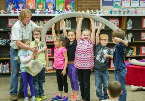 John L. Ford brings real whale bones so students can learn first-hand the immense size of these underwater creatures. Photo courtesy of Woodland Public Schools