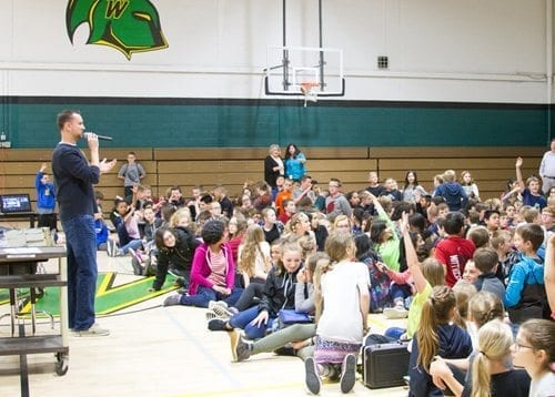 During his presentation recently at Woodland Middle School, Chad Trisef shares how he developed his book series from his love of mysteries. Photo courtesy of Woodland Public Schools