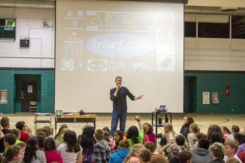 Chad Trisef, a self-published author, visits schools around the country to promote literacy and talk to kids about the importance of helping others. He recently made a stop at Woodland Middle School. Photo courtesy of Woodland Public Schools