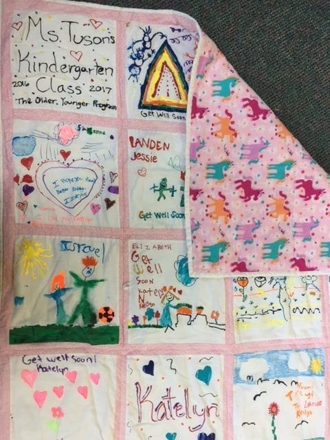 This quilt was created by students in the Older-Younger kindergarten program in the Battle Ground School District and presented to an area youth who was in the hospital receiving treatment for cancer. Photo courtesy of Battle Ground School District
