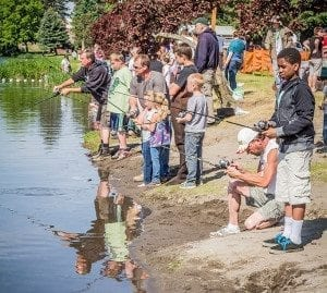 Anglers have been catching daily limits of trout at lakes around the state of Washington this month, according to Washington Department of Fish and Wildlife officials. Area anglers are shown here at a recent fishing derby at Horseshoe Lake in Woodland. Photo by Mike Schultz