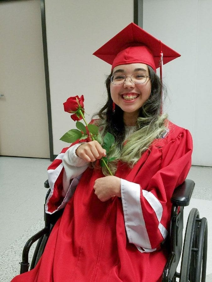 Jessica Beckman is all smiles, holding a rose during Saturday's graduation ceremony. The Fort Vancouver graduate suffered a stroke when she was a freshman but managed to graduate on time, with her class. Photo courtesy of The Beckman Family
