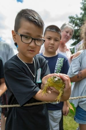 Six-year-old Bentley Ahn, of Woodland, shows off the frog he captured for the annual Frog Jumping Contest at the 2017 Woodland Planters Days celebration. Photo by Mike Schultz