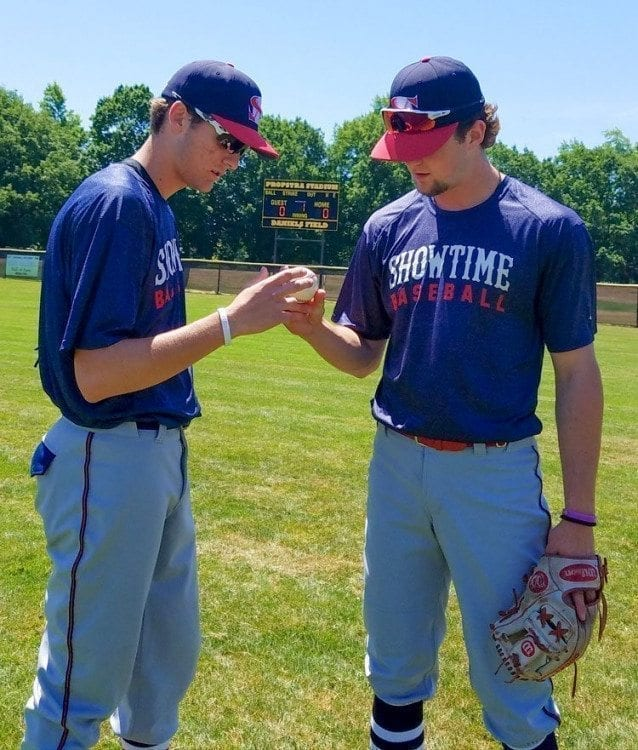 Damon Casetta-Stubbs (left) shows Showtime Baseball teammate Daniel Copelan his grip for a particular pitch. The two shined this week, along with the rest of the team, at an event in Texas. Showtime then made it back in time for the Curt Daniels Invitational. Photo by Paul Valencia