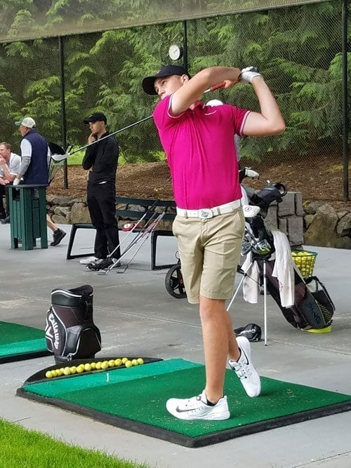 Spencer Tibbits practices at the driving range Thursday in preparation for the Royal Oaks Invitational Tournament. He is the defending champion. Photo by Paul Valencia