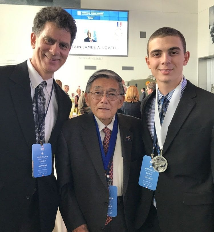 Mitchell Leon (right) and his father Mike (left) got to meet former congressman and Secretary of Transportation Norman Mineta at the American Spirit Awards at the National World War II Museum in New Orleans. Photo courtesy of the Leon family