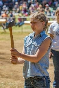 Delaney Brown shows the concentration she used to place first in the 10-13 age division of the axe throw at the Amboy Territorial Days competition Saturday. Photo by Mike Schultz