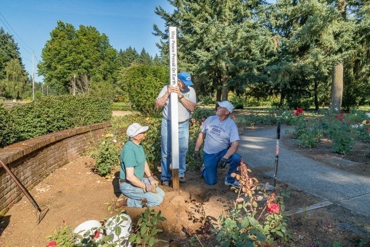Vancouver Sunrise Rotary Club members (from left-to-right) John Schaffers, Bob Ives and David Weedman gathered Saturday morning to install a Peace Pole at Orchards Park. Photo by Mike Schultz