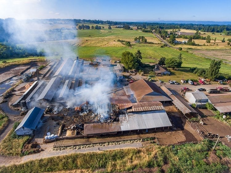 Clark County Fire and Rescue spokesman Tim Dawdy said crews were called at 2:09 a.m. Wednesday to the scene of a blaze in Ridgefield. By the time they arrived at the scene, the large barn was already engulfed by the fire. Photo by Mike Schultz