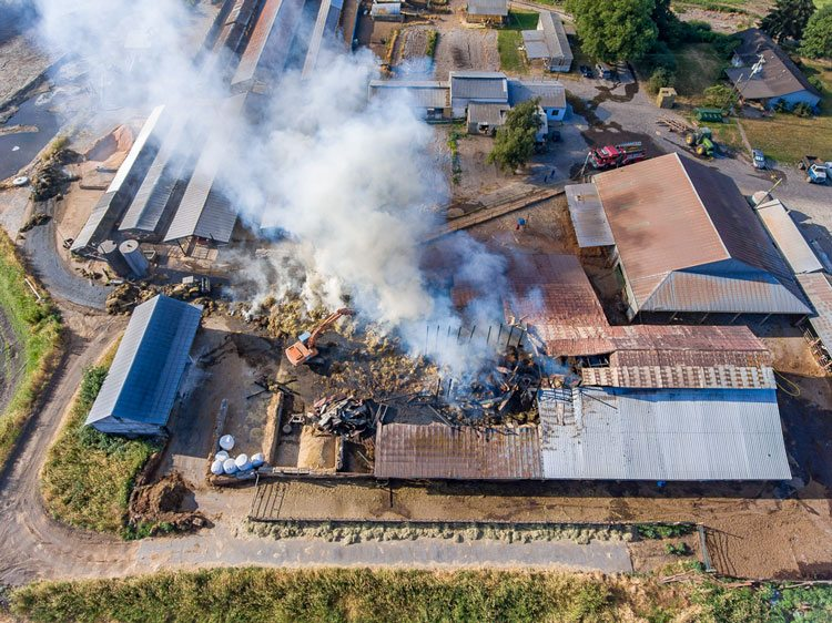 Crews were still on the scene Wednesday afternoon at a fire that destroyed a large barn at a residence located at 23117 NW Hillhurst Rd. in Ridgefield. Photo by Mike Schultz