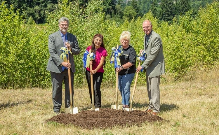 State Representative Ed Orcutt, Woodland Rotary President Asha Riley, Scott Hill Park Project Committee Chairwoman Sandy Larson and Woodland Mayor Will Finn perform the ceremonial shovel in the dirt groundbreaking Thursday in Woodland. Photo by Mike Schultz