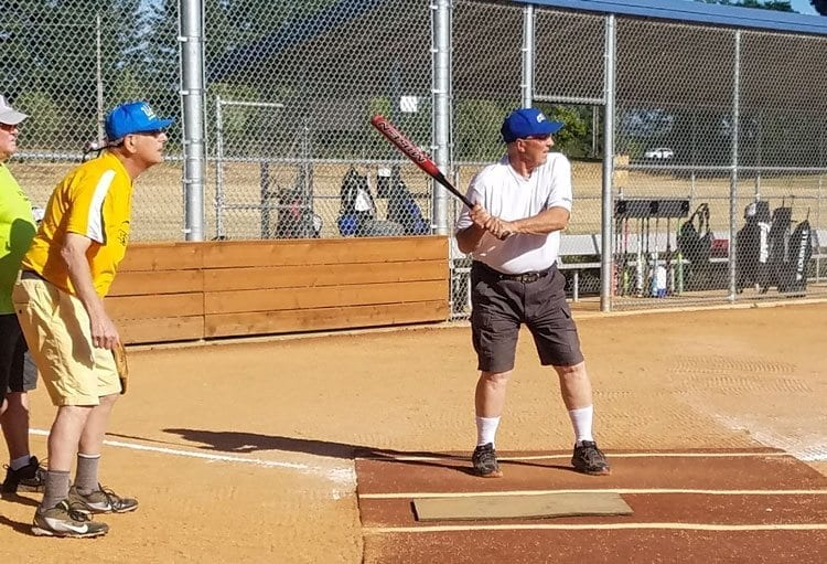 John Aarhus, the president of the Vancouver Metro Senior Softball Association, waits for a pitch during a game Monday night at Sunlight Supply Field. The VMSSA raised more than $300,000 to build the new field. Photo by Paul Valencia.