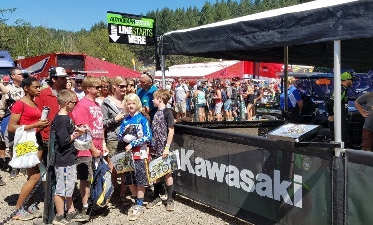 The Scharrelman family of Camas made it to the front of the line to get Eli Tomac's autograph. They waited there for 2 hours, 45 minutes and were all smiles. Photo by Paul Valencia