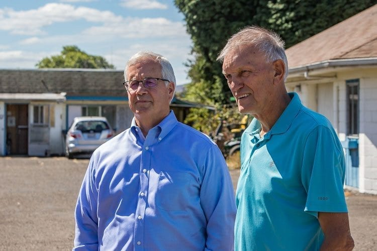 Bob Hall (on left), president and CEO of the YMCA of Columbia-Willamette, and Benno Dobbe (on right), chairman of the Woodland Swimming Pool Steering Committee, discuss the effort to bring a community swimming pool to Woodland. Photo by Mike Schultz