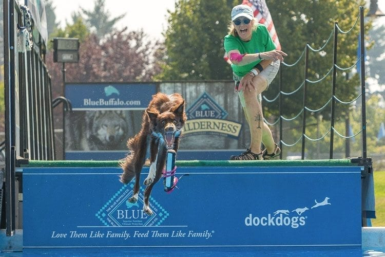 Vickie Francks, of Kenmore, Wa., shows off the talents of her dog Haven during the Dock Dogs exhibition. Photo by Mike Schultz