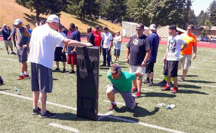 "The purpose of the clinic was to ""coach the coaches, teach the teachers."" More than 100 Clark County Youth Football coaches went through tackling drills Saturday at McKenzie Stadium. Photo courtesy of CCYF"