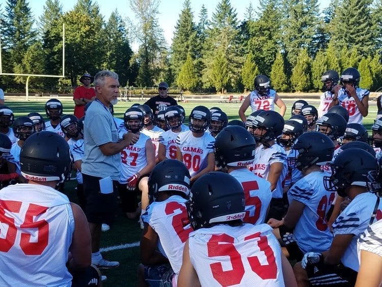 Coach Jon Eagle talks to his team on the first day of practice, reminding the Papermakers that even though there will be a lot of new starters, this remains a quality team. Photo by Paul Valencia