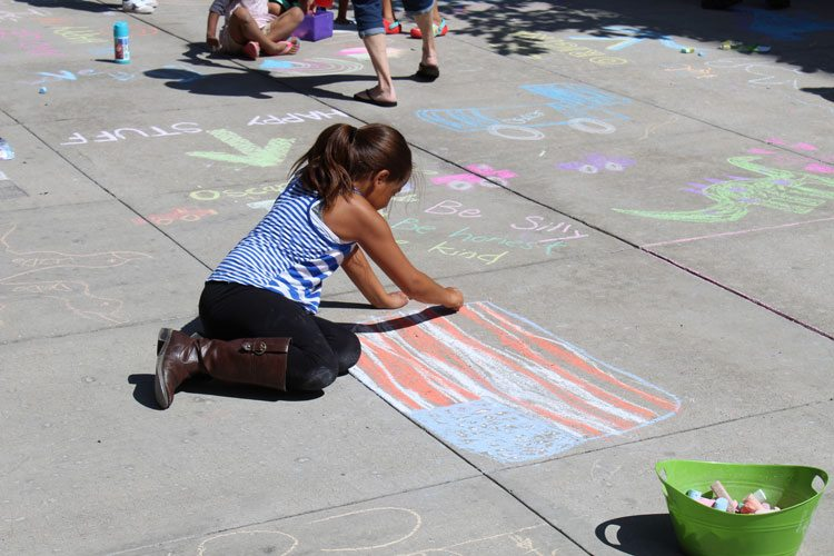 Children were given chalk and were encouraged to tap into their creativity to spread color around City Hall in Vancouver Tuesday at the annual Chalk the Walks event. Photo by Alex Peru