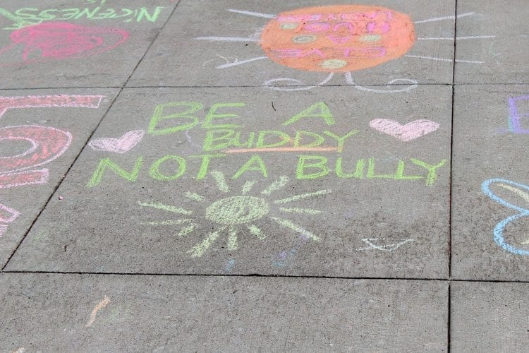 Positive and encouraging messages abounded in the chalk art at the Chalk the Walks event Tuesday. Photo by Alex Peru