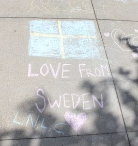 The Martensson family was visiting Vancouver from Sweden and stopped by Chalk the Walks, sending greetings from across the Atlantic. Photo by Alex Peru