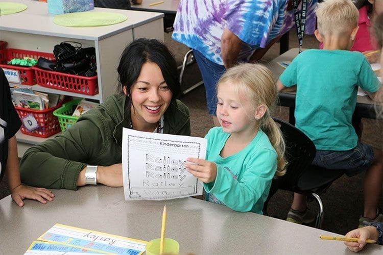 Daybreak Primary assistant principal Solina Journey helps a new kindergarten student with an art project. Photo courtesy of Battle Ground Public Schools