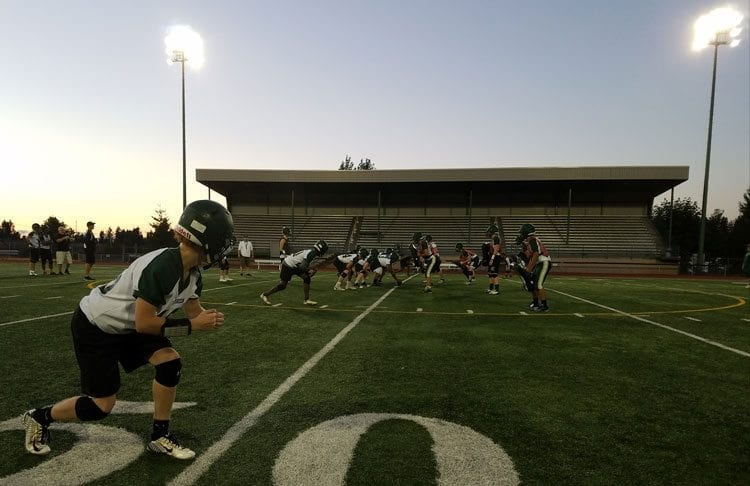 The Evergreen Plainsmen, practicing under the lights here, hope to glow under Friday night lights this season, in search of a winning record. Photo by Paul Valencia
