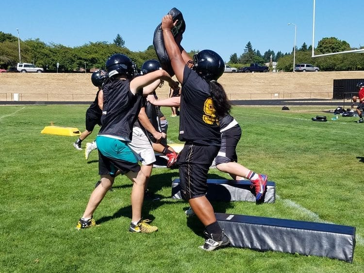 Angel Terry, right, made the all-league team as a defensive linemen in 2016. He will be key on offense and defense this season. Photo by Paul Valencia