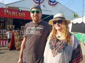 Jeremy Rogers and Stephanie Wood, both of Vancouver, said they love standing in line with so many people for a free breakfast at the opening day of the Clark County Fair. Photo by Paul Valencia