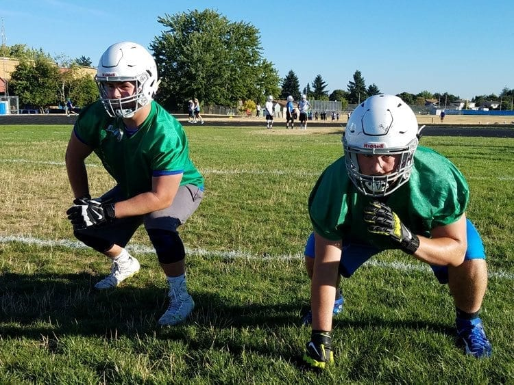 Joey Roberts, left, and Zeek Fromel are leaders on and off the football field for the Mountain View Thunder. They want this season to be memorable for more than just the performances in games. Photo by Paul Valencia