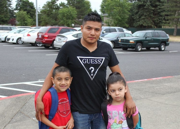 Parents brought their children to Ogden Elementary School and stopped to take photos before they started their first day of classes. Photo by Alex Peru