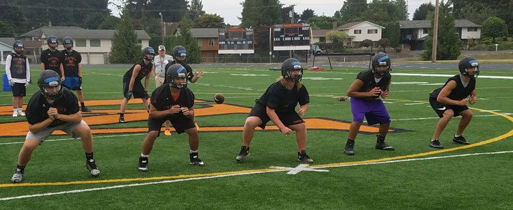 Four of the five offensive linemen have started at least nine games in their varsity careers. That experience leads coach David Hajek to believe this could be one of the best seasons in years for Washougal. Photo by Paul Valencia