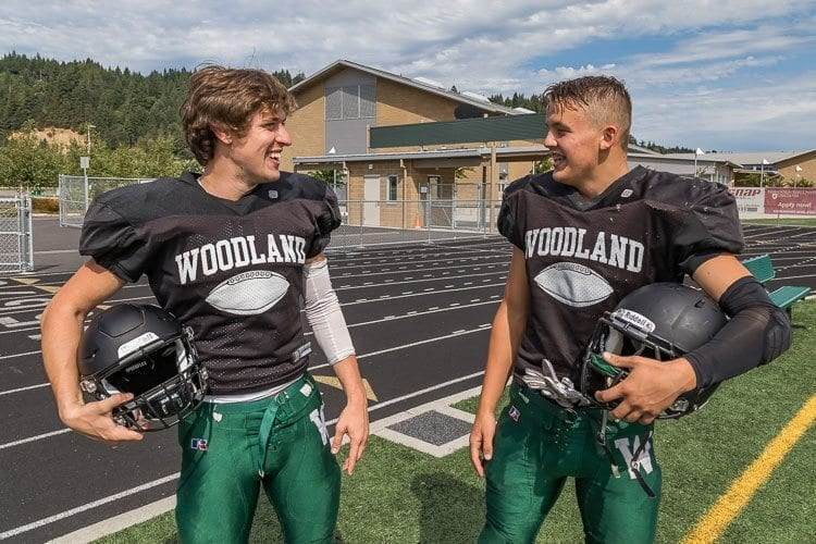 Wyatt Harsh (on left) will be Woodland's starting quarterback for the fourth consecutive season. Teammate Tyler Flanagan (on right) is considered one of the best athletes in the Class 2A Greater St. Helens League. Photo by Mike Schultz