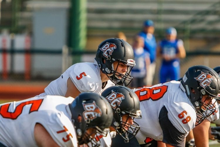 Battle Ground quarterback Seth Workman (5) prepares to take a snap in last week's game with Mountain View. Workman and the Tigers face district-rival Prairie in Week 4. Photo by Mike Schultz