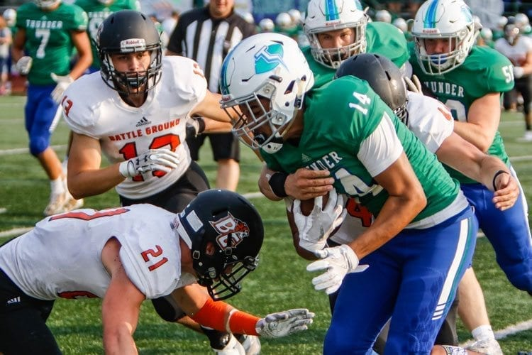 Battle Ground's Brock Robinson (21) moves to make a tackle in a game earlier this season with Mountain View. Robinson rushed for 275 yards in last week's loss to Prairie. Photo by Mike Schultz