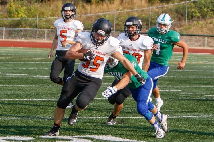 Battle Ground running back Jordan Sullivan (35) attempts to elude a Mountain View defender in Friday's non-league game at McKenzie Stadium. Photo by Mike Schultz