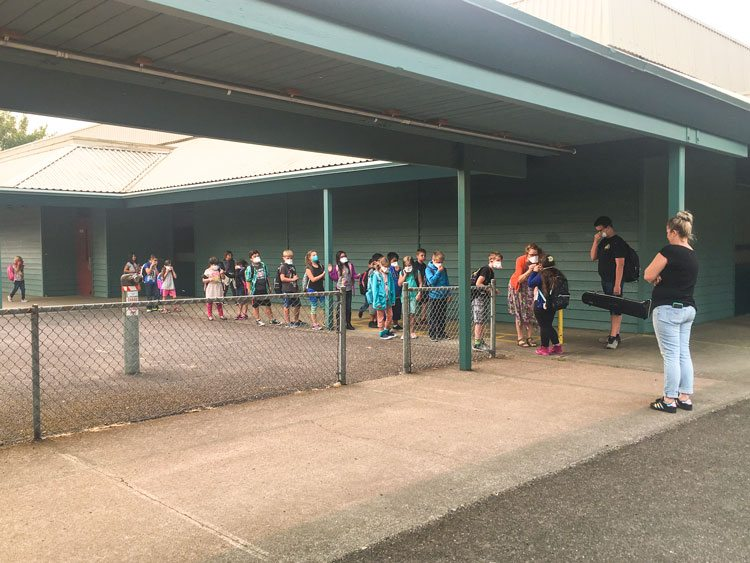 Staff at Burton Elementary School assisted students with taking precautions to deal with the impact of smoke and ash in the air from the fires in the Columbia River Gorge. Photo by Andi Schwartz