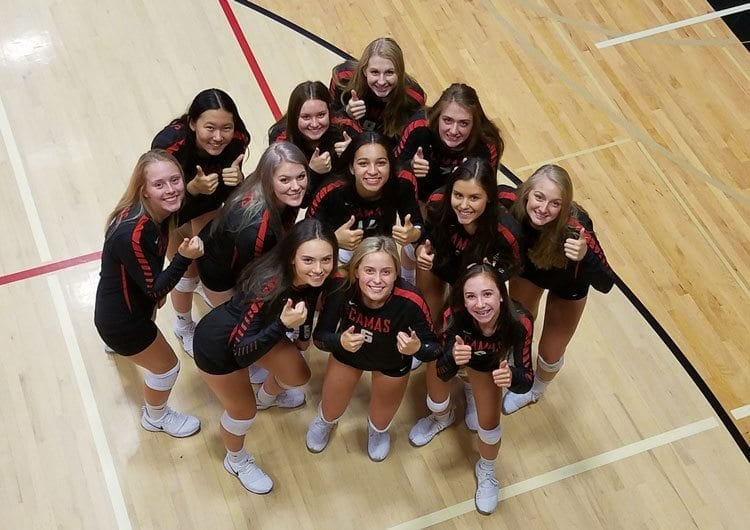 The Camas Papermakers are committed to making everyone on the volleyball team feel like family.  Photo by Paul Valencia