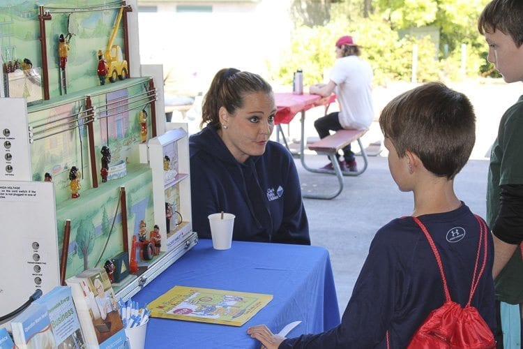 Staff at different agency booths were happy to answer questions from visitors of all ages. Photo by Alex Peru