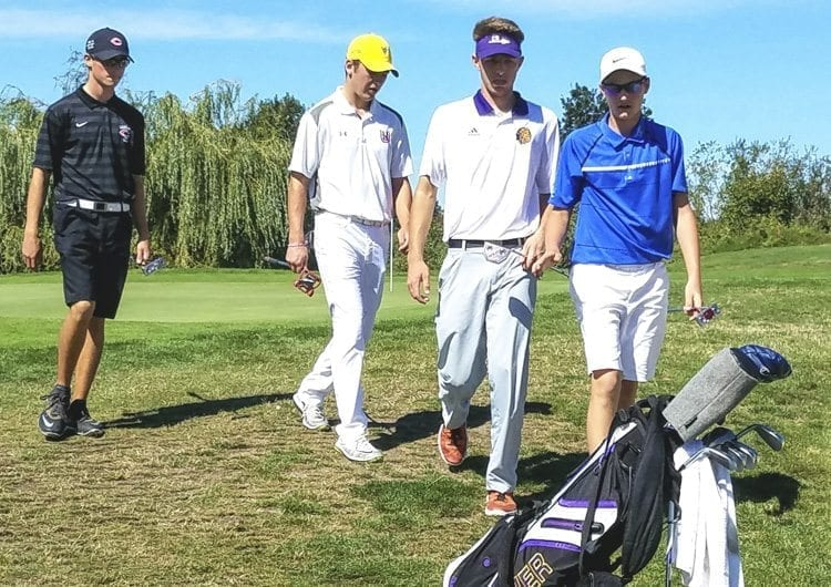 From left to right, Owen Huntington of Camas, Keith Lobis of Union, Kyle Gomez of Columbia River, and Graham Moody of Mountain View, walked a round of golf Tuesday at the Jim Hudson Invitational. Two seniors and two freshmen would later talk about the state of the game in Clark County this high school season. Photo by Paul Valencia