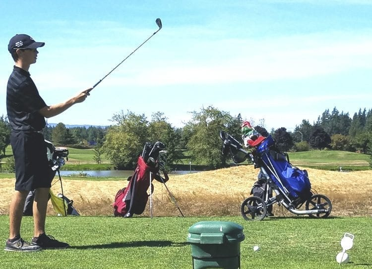 Owen Huntington of Camas prepares to tee off on the par-3 15th hole at Tri-Mountain Golf Course. He is one of the top freshmen in the county. Photo by Paul Valencia