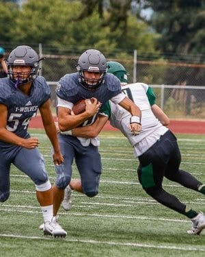 Heritage quarterback Michael Taras (10) will lead the Timberwolves into a Friday matchup against Redmond. Photo by Mike Schultz