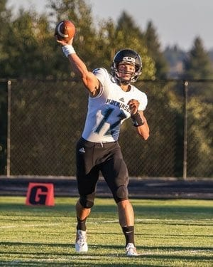 Hockinson quarterback Canon Racanelli (12) passed for over 300 yards and rushed for over 100 yards and finished with six touchdowns in the Hawks' Week 3 win over Woodland. Racanelli is shown here in a game at La Center earlier this season. Photo by Paul Valencia