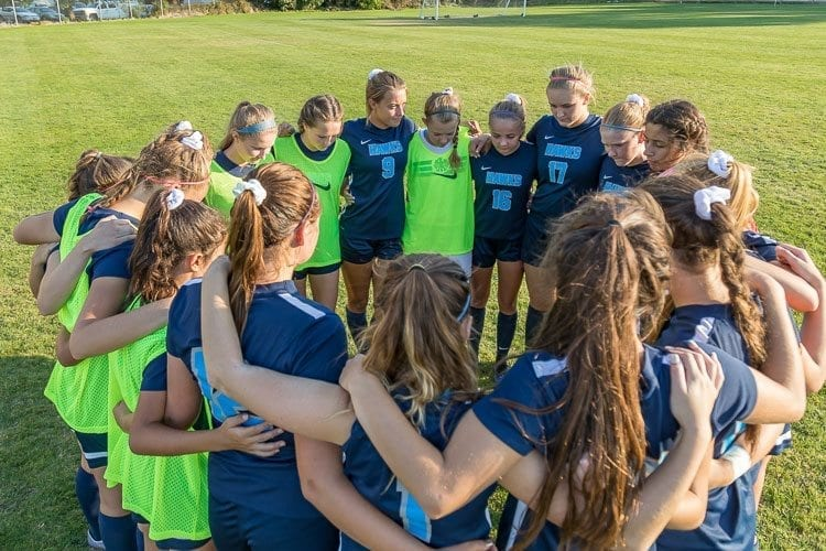 Members of the Hockinson girls soccer team are taking a team approach into this season, one in which the Hawks will end with a deep run into the Class 2A state playoffs. Photo by Mike Schultz