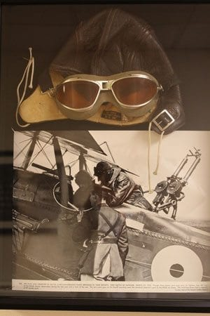 Another artifact in the hall is a pair of World War I era flying goggles, accompanied by a historic photograph from the war. Photo by Alex Peru