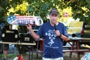 Nate Chumley, owner of America's Family Diner, auctioned off a hand-painted skateboard honoring American veterans during the live auction portion of the event. Photo by Alex Peru